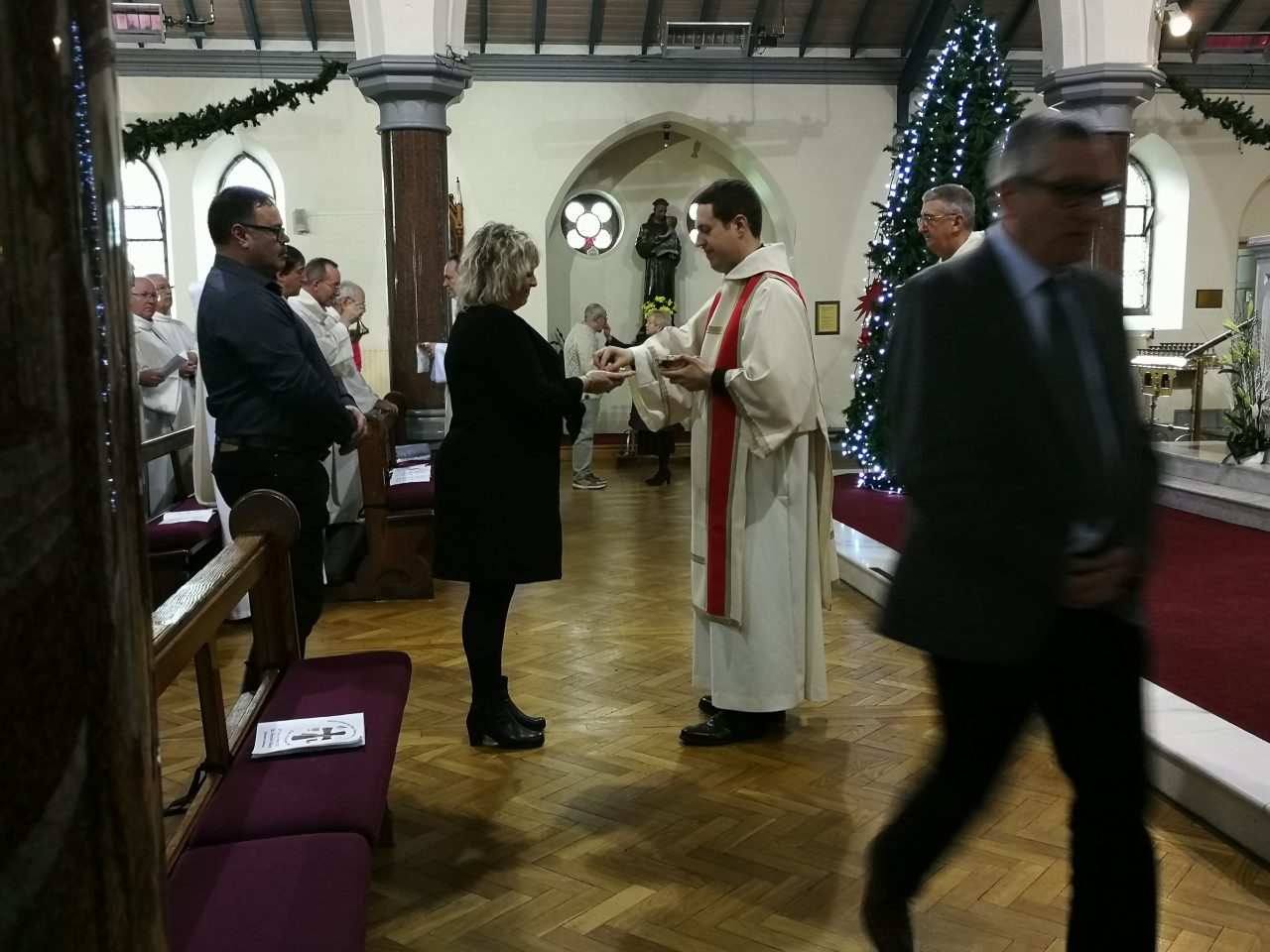 Deacon Tom Distributes Holy Communion