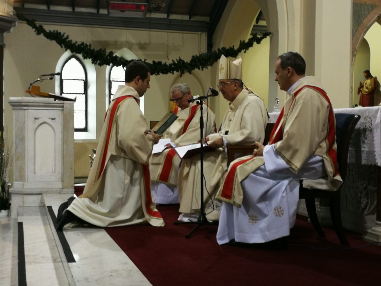 Deacon Tom is blessed by Archbishop Diarmuid Martin before he reads the Gospel