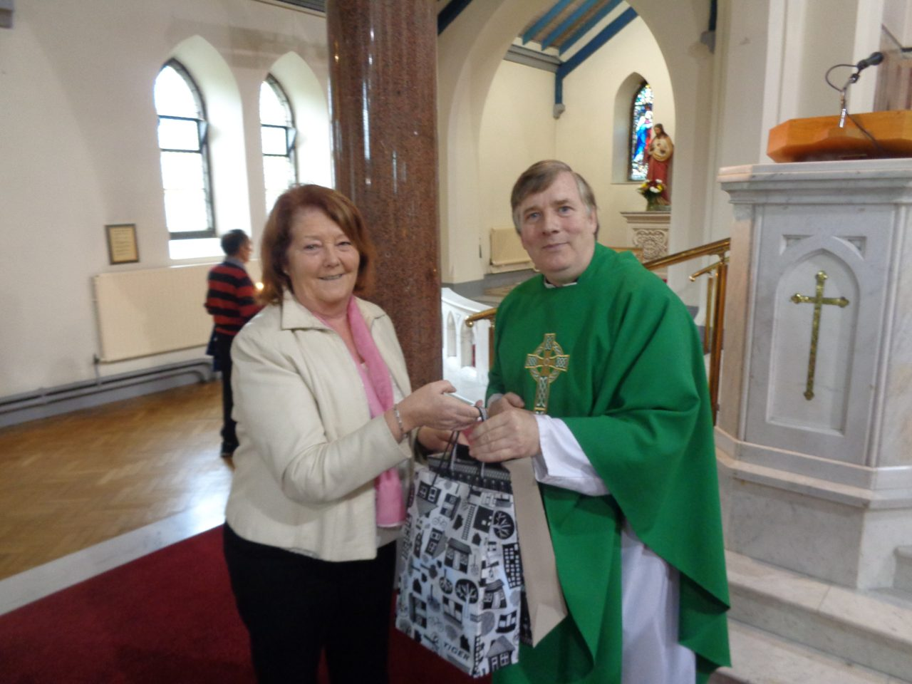 Lily Curtis makes a presentation to Fr. Cormac at his Farewell Mass on 22nd October 2017