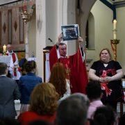 Fr. Cunningham receives the Scoil Treasa Naofa Class PhotoDSC_6920