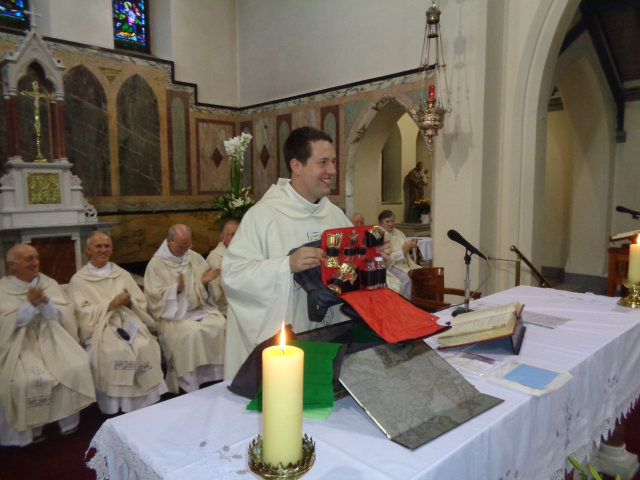 Fr. Tom Shows His Present from the Parish to the Congregation