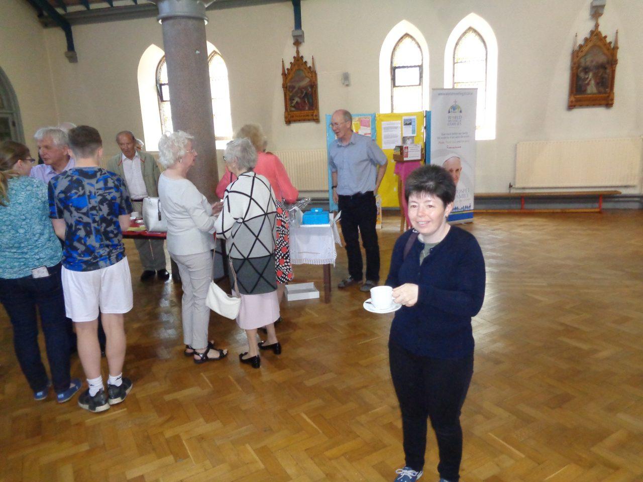 Parishioners Enjoying Tea After the Mass