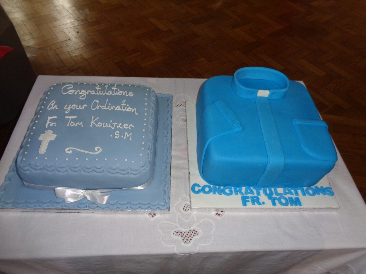 Fr. Tom has not just one but two cakes to celebrate his First Mass