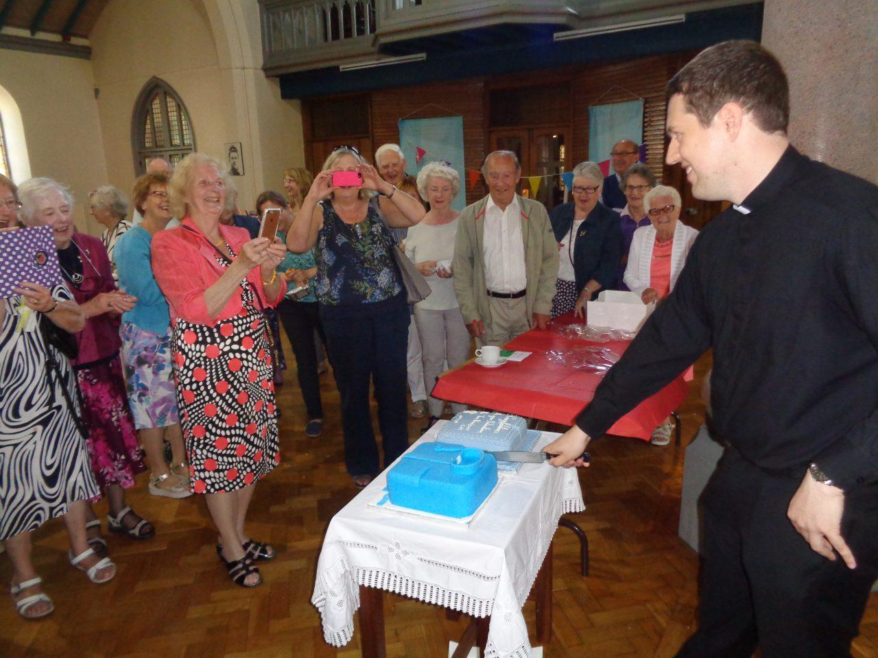 Fr. Tom Cuts His Cake