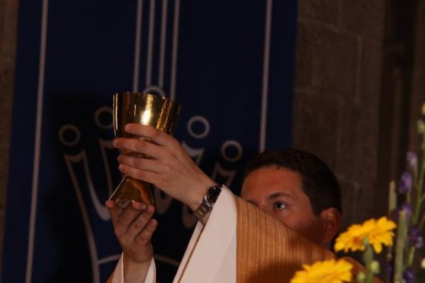 Fr. Tom Raises the Chalice during his First Mass in Hulst