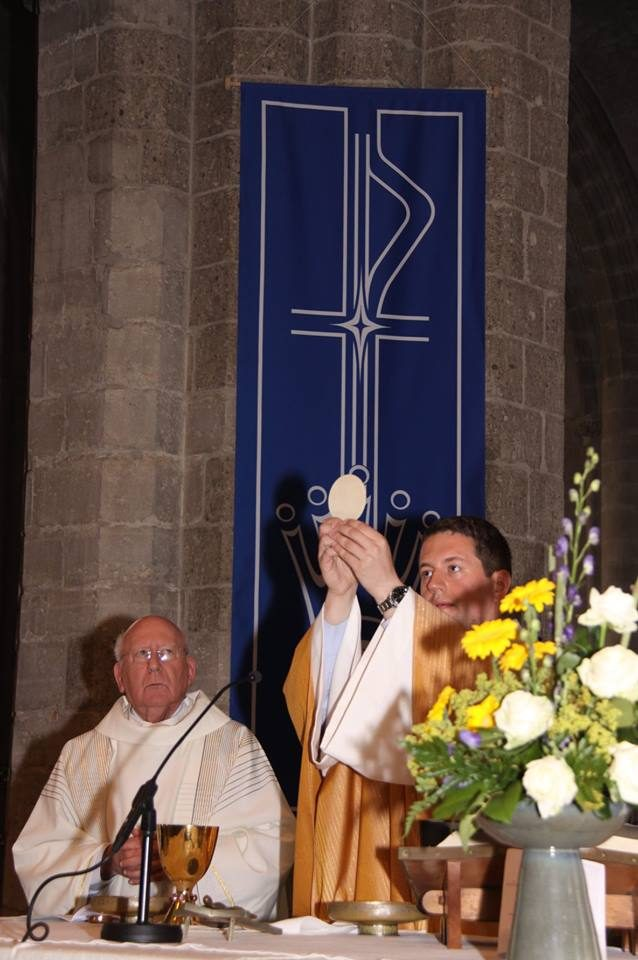 Fr. Tom Raises the Host during his First Mass in Hulst