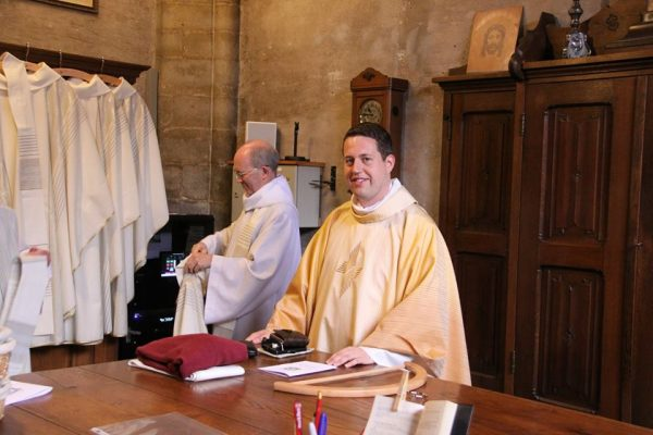 Fr. Tom with Fr. David in the sacristy after his first Mass in Hulst