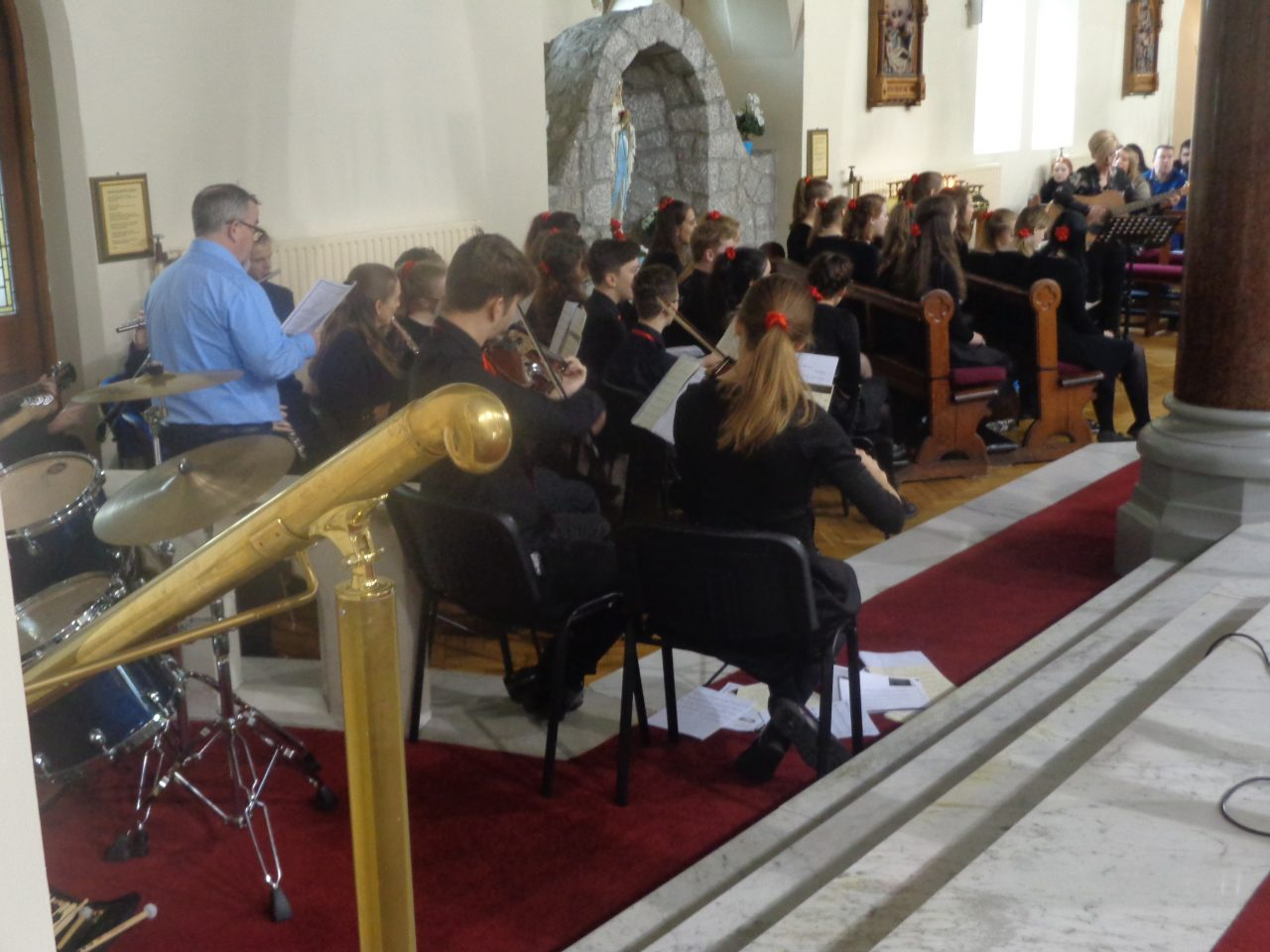 Choir from St Nicholas Catholic High School in Cheshire Playing Their Instruments